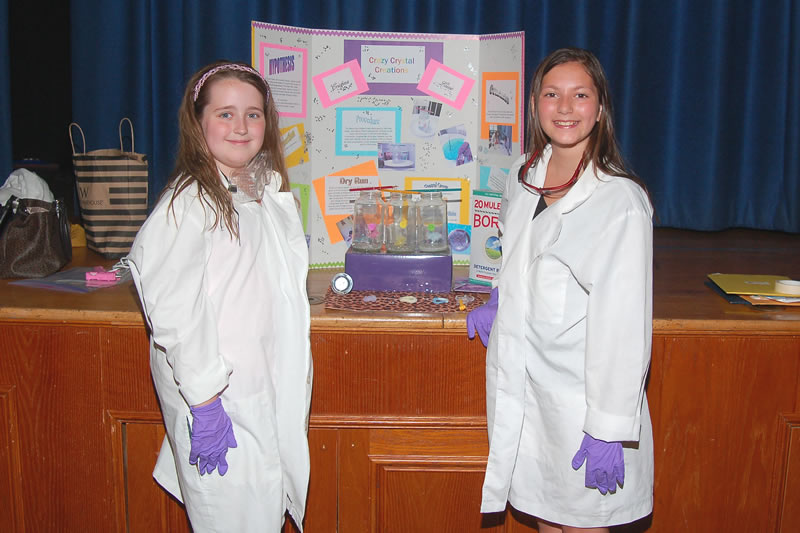 "Elizabeth Reavey (left) and Cristina Marsicano with their experiment entitled ""Crazy Crystal Creations"""