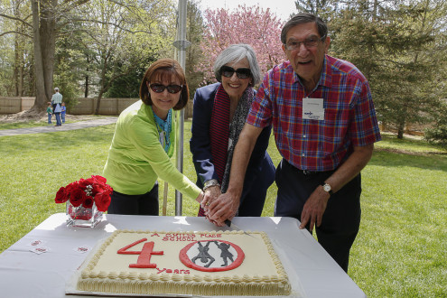 Linda and Abe Littenberg, owners of A Child's Place cut the anniversary cake with founder Alba DiBello (center) at the 40th anniversary celebration of the school in Lincroft, NJ.