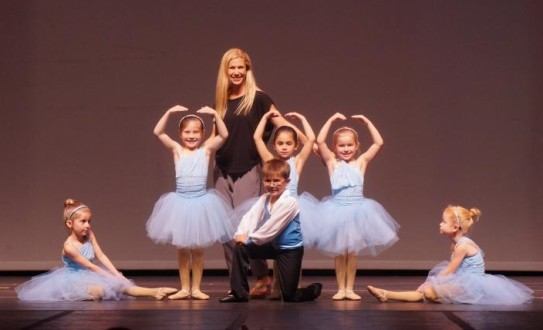 Kick Dance Studios Owner Vanessa Berry on stage with her students (Photo credit: Caroline Keating)