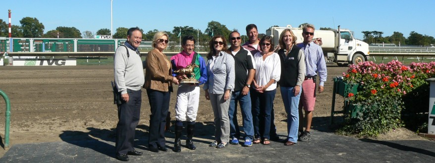Pictured in the winner's circle at Monmouth Park are members of the RBR Buc Bucker Foundation with the winner of last year's 50/50 and the RBR race winners. The RBR Buc Backer Foundation Day at the Races takes place this year on Saturday, September 21.