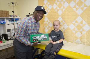 Mickey Rivers donating Hess toys to children at Monmouth Medical Center